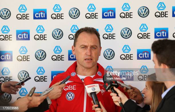 Sydney Swans AFL coach John Longmire speaks with the media at Moore Park on July 1 2013 in Sydney Australia
