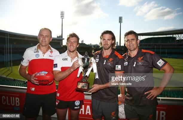 Sydney Swans coach John Longmire and vicecaptain Luke Parker pose alongside GWS Giants coach Leon Cameron and captain Callan Ward during an AFL press...