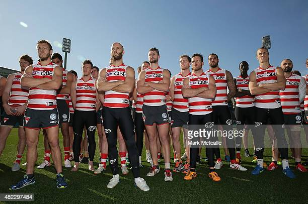 Sydney Swans players stand in solidarity for team mate Adam Goodes as Swans Chief Executive Andrew Ireland speaks to the media prior to a Sydney...