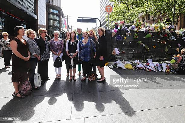 Sydney Threshold Choir sings as a sign of respect at Martin Place on December 17 2014 in Sydney Australia Sydney siege gunman Man Haron Monis was...