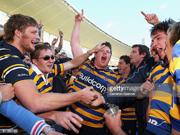 Sydney University players celebrate with fans after the Shute Shield Grand Final match between Sydney University and Randwick at Sydney Football...