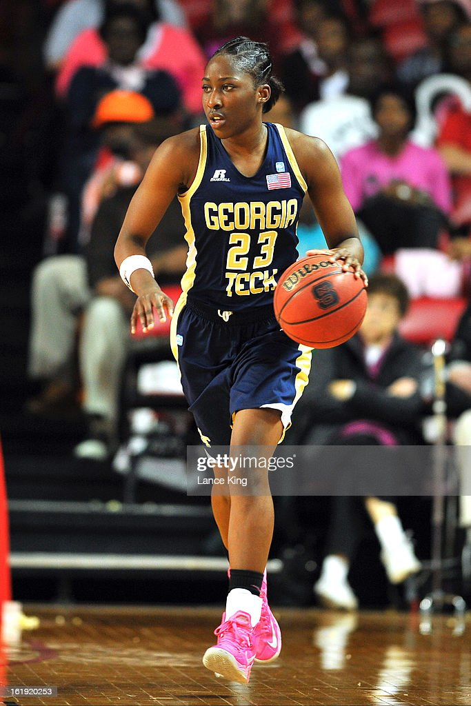Sydney Wallace #23 of the Georgia Tech Yellow Jackets dribbles against the North Carolina State Wolfpack at Reynolds Coliseum on February 17, 2013 in Raleigh, North Carolina.
