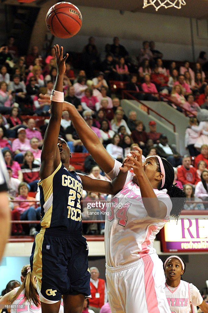 Sydney Wallace #23 of the Georgia Tech Yellow Jackets puts up a shot against Markeisha Gatling #34 of the North Carolina State Wolfpack at Reynolds Coliseum on February 17, 2013 in Raleigh, North Carolina.