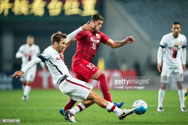 Sydney Wanderers Midfielder Steven Lustica fights for the ball with Shanghai FC Forward Givanildo Vieira De Sousa during the AFC Champions League...