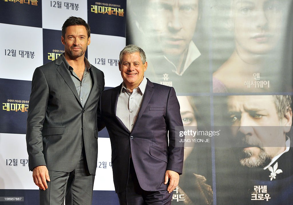 Sydney-born Hollywood star actor Hugh Jackman (L) and producer Cameron Mackintosh (R) pose for a photo before a press conference to promote their film 'Les Miserables' at a hotel in Seoul on November 26, 2012. The film will open in December in South Korea. AFP PHOTO / JUNG YEON-JE