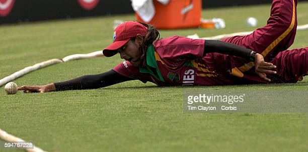 West Indian fielder Anisa Mohammed can't prevent four runs as she follows the ball over the boundary line during the West Indies V New Zealand group...