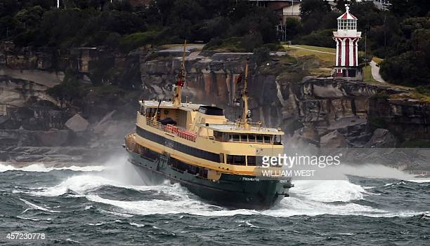 Sydney's Manly ferry ploughs through the waves after gale force winds torrential rain and snow wreaked havoc across Sydney and surrounding areas on...