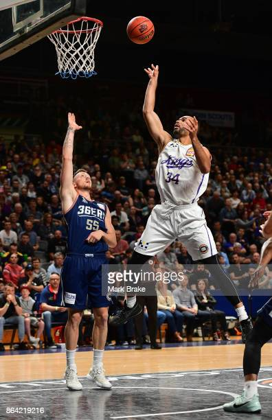 Sydneys Perry Ellis shoots over Mitch Creek during the round three NBL match between the Adelaide 36ers and the Sydney Kings at Titanium Security...