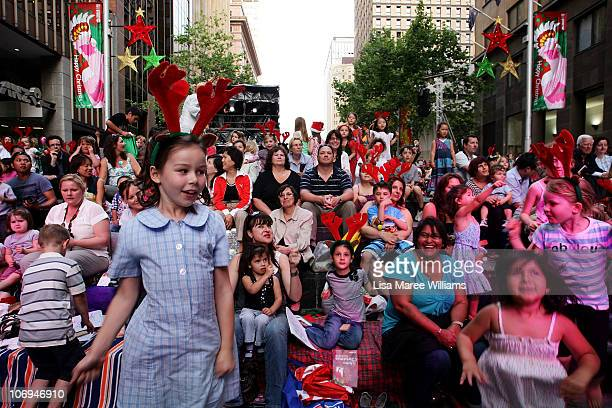 Sydneysiders attend the City of Sydney Christmas concert and Christmas tree lighting at Martin Place on November 18 2010 in Sydney Australia Large...