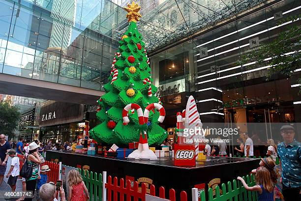 Sydneysiders look at a Christmas tree display made from Lego at Pitt Street Mall during the Christmas shopping period on December 7 2014 in Sydney...