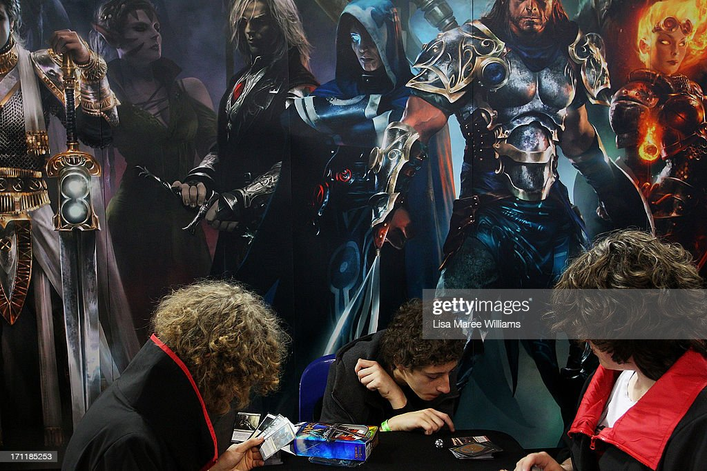 Sydneysiders play a card game 'Magic The Gathering' during the 2013 Supanova pop culture festival at Sydney Showground on June 23, 2013 in Sydney, Australia.