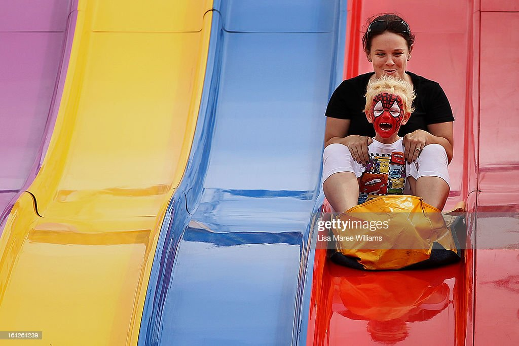 Sydneysiders take on the 'Super Slide' at the Sydney Royal Easter Show on March 22, 2013 in Sydney, Australia. Organisers are expecting over 900,000 visitors to the annual agricultural event, the largest of its kind in Australia. The Easter Show marks its 190th show since opening in Paramatta in 1823.