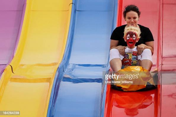 Sydneysiders take on the 'Super Slide' at the Sydney Royal Easter Show on March 22 2013 in Sydney Australia Organisers are expecting over 900000...