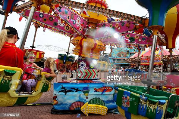 Sydneysiders take to the rides at 'Side Show Alley' during the Sydney Royal Easter Show on March 22 2013 in Sydney Australia Organisers are expecting...
