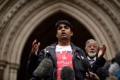 Syed Abul Ahsan and his son Hamja speak to the media after the Royal Court's of Justice refused his son Tahla Ahsan leave to appeal against...