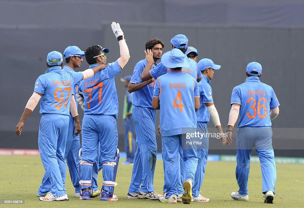 Syed Khaleel Ahmed of India the wicket of Wanidu Hasaranga of Sri Lanka during the ICC U19 World Cup Semi-Final match between India and Sri Lanka on February 9, 2016 in Dhaka, Bangladesh.