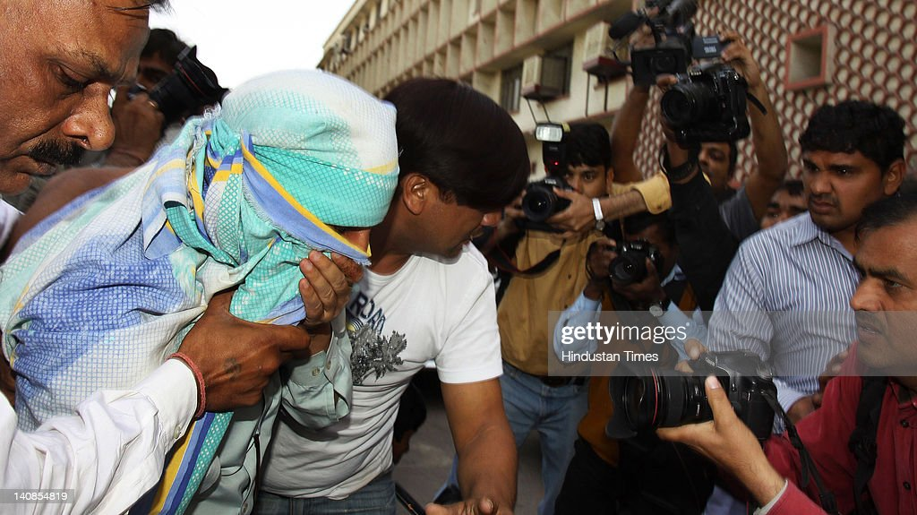 Syed Mohammed Ahmad Kazmi (2L), who was arrested by the Delhi Police Special branch for alleged involvement in the Israeli embassy blast, is taken into Tis Hazari Court on March 7, 2012 in New Delhi, India. On February 13, 2012 four people including Israeli diplomat Tal Yehoshua and her Indian driver were injured in a blast after a magnetic bomb was stuck to their vehicle. According to police sources Kazmi was in contact with the people believed to have placed the magnetic bomb on the car.