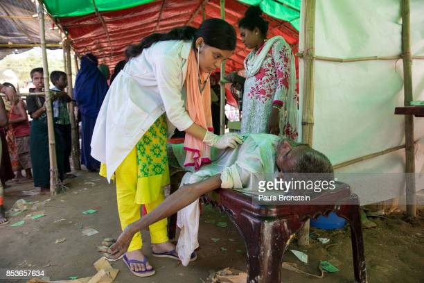 Syed Noor 50 is treated at a medical tent after collapsing from a seizure from Epilepsy on September 25 2017 in Balukhali camp Cox's Bazar Bangladesh...