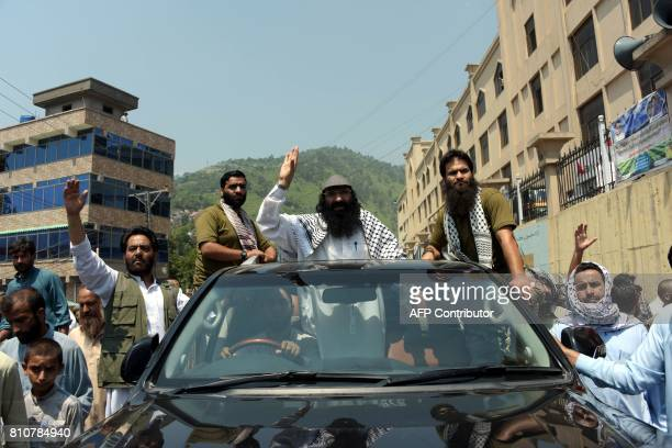 Syed Salahuddin senior leader of the Kashmiri militant group HizbulMujahideen waves to supporters as he leaves after a rally to mark the first...