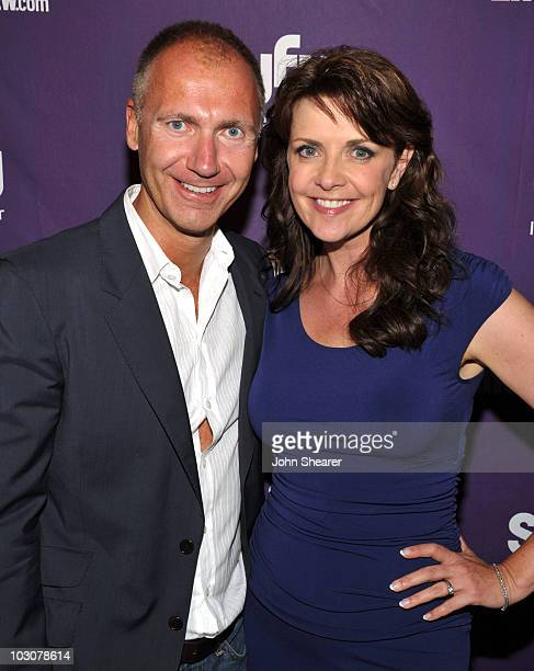 SyFy President David Howe and actress Amanda Tapping attend the EW and SyFy party during ComicCon 2010 at Hotel Solamar on July 24 2010 in San Diego...