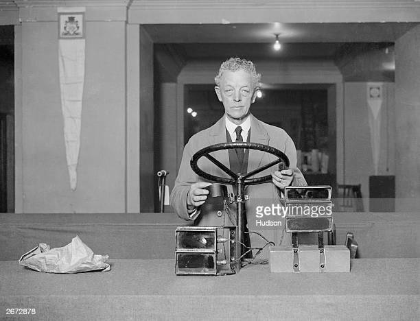 E D Sykes with his invention of motor car signals which are controlled from a steering wheel column on display at the International Exhibition of...