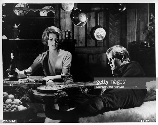 Sylva Koscina and David McCallum have a rendezvous at a ski lodge in a scene from the MGM movie 'Three Bites of the Apple' circa 1967