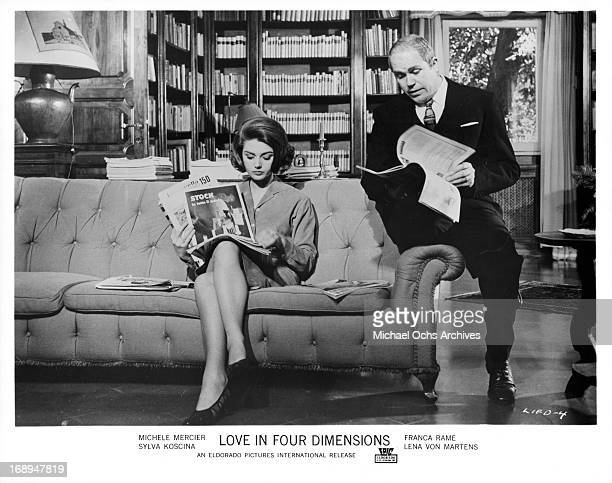Sylva Koscina and Gastone Moschin read magazines in a scene from the film 'Love In Four Dimensions' 1964