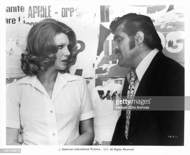 Sylva Koscina and Mario Adorf talk about his concern in a scene from the film 'The Italian Connection' 1973