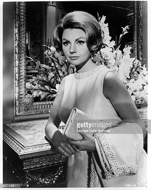 Sylva Koscina as Carla Moretti looks on in a scene from the MGM movie 'Three Bites of the Apple' circa 1967