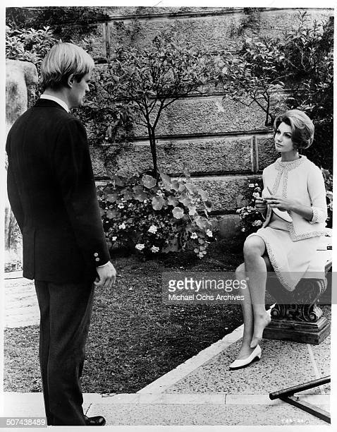 Sylva Koscina holds a broken heel to lure tour guide David McCallum to make a acquaintance in a scene from the MGM movie 'Three Bites of the Apple'...