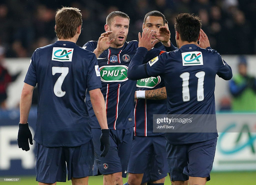 Sylvain Armand (2nd L), Ezequiel Lavezzi (R) and PSG team-mates celebrate victory at the end of the French Cup match between Paris Saint Germain FC and Toulouse FC at the Parc des Princes stadium on January 23, 2013 in Paris, France.