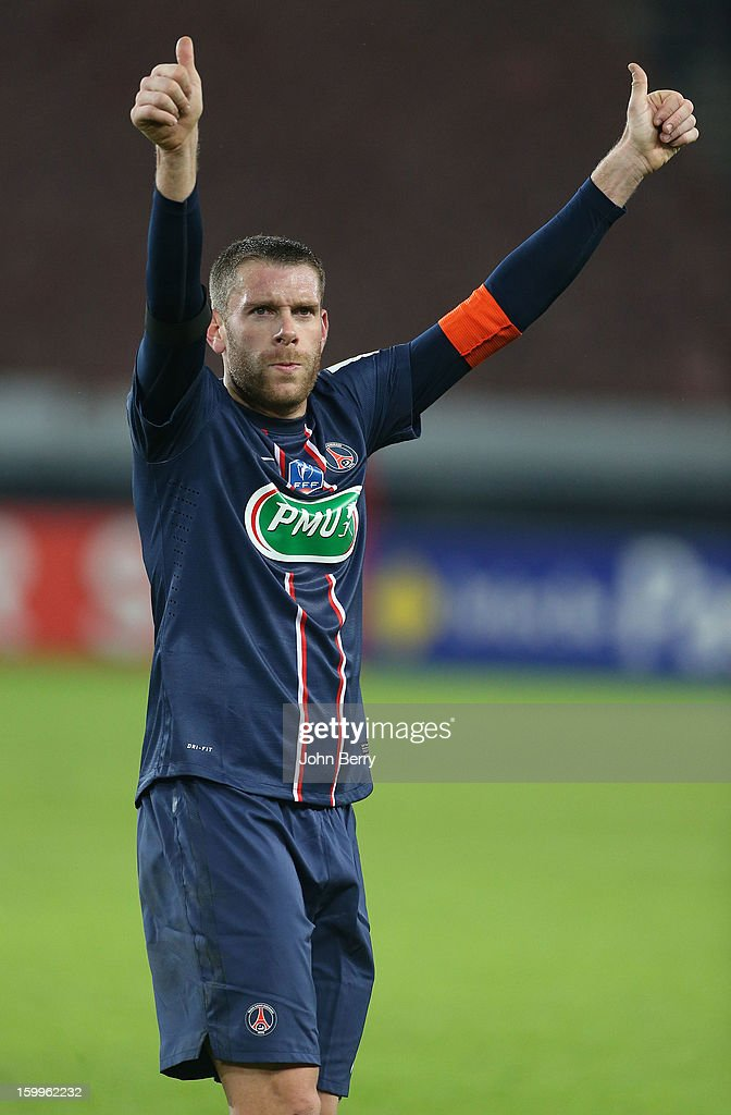 Sylvain Armand of PSG celebrates his team's victory at the end of the French Cup match between Paris Saint Germain FC and Toulouse FC at the Parc des Princes stadium on January 23, 2013 in Paris, France.