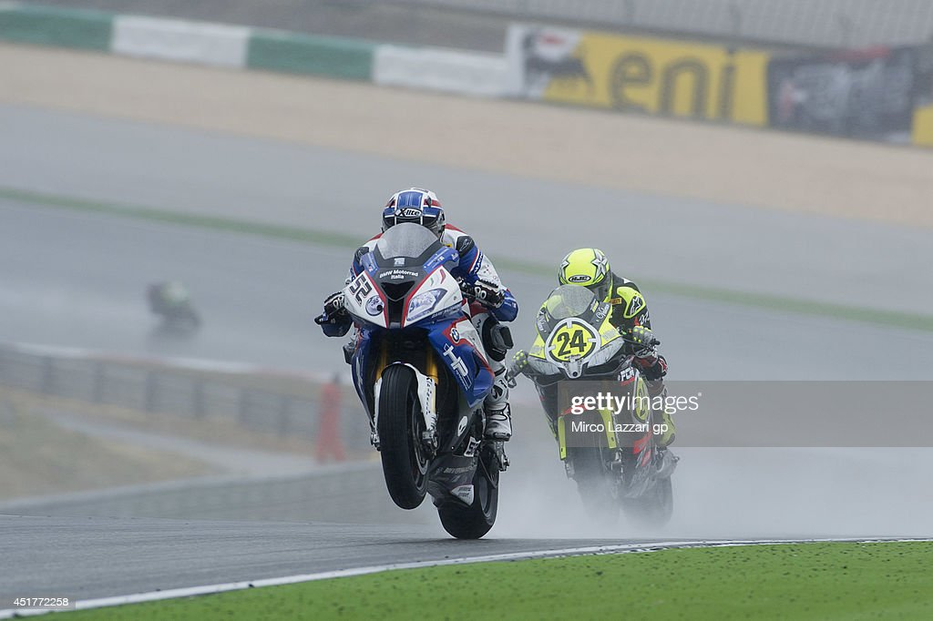 Sylvain Barrier of France and BMW Motorrad Italia SBK leads the field during the race 2 during the FIM Superbike World Championship - Race at Portimao Circuit on July 6, 2014 in Portimao, Portugal.