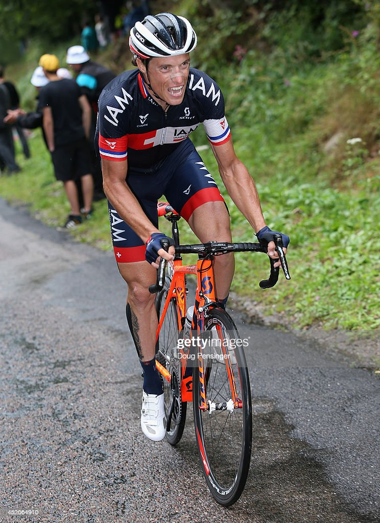 <a gi-track='captionPersonalityLinkClicked' href=/galleries/search?phrase=Sylvain+Chavanel&family=editorial&specificpeople=547829 ng-click='$event.stopPropagation()'>Sylvain Chavanel</a> of France and IAM Cycling attacks the breakaway on the climb of the Col de la Croix des Moinats during stage eight of the 2014 Le Tour de France from Tomblaine to Gerardmer La Mauselaine on July 12, 2014 in Presle, France.