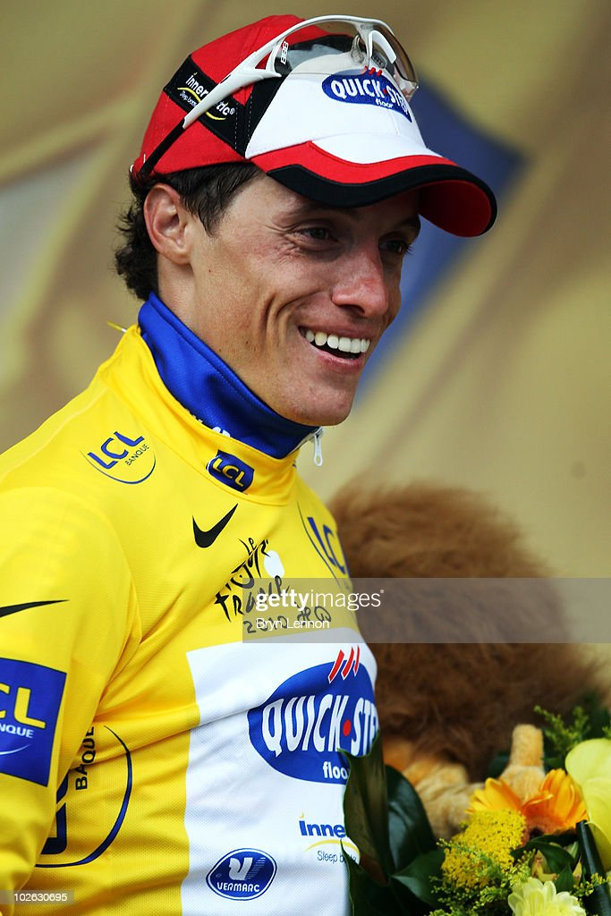 <a gi-track='captionPersonalityLinkClicked' href=/galleries/search?phrase=Sylvain+Chavanel&family=editorial&specificpeople=547829 ng-click='$event.stopPropagation()'>Sylvain Chavanel</a> of France and Quick Step smiles after becoming the new race leader and yellow jersey holder after winning stage two of the 2010 Tour de France from Brussels to Spa on July 5, 2010 in Spa, Belgium.