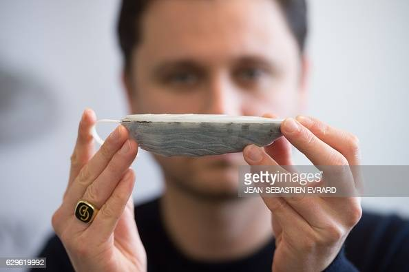 Sylvain Dardenne commercial director of the FlexSense company shows an antitheft device for oysters on December 12 2016 in La Rochesuryon western...