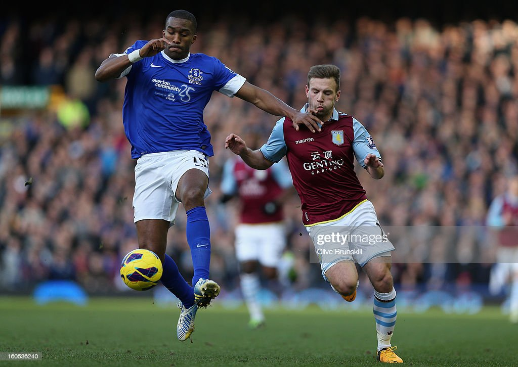 Sylvain Distin of Everton holds off Andreas Weimann of Aston Villa during the Barclays Premier League match between Everton and Aston Villa at Goodison Park on February 2, 2013 in Liverpool, England.
