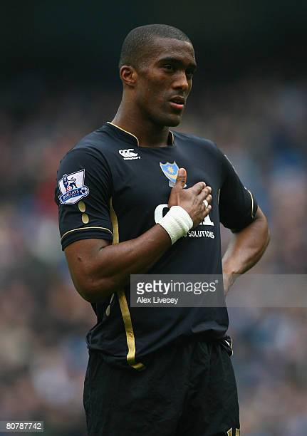 Sylvain Distin of Portsmouth gestures to the Manchester City fans during the Barclays Premier League match between Manchester City and Portsmouth at...