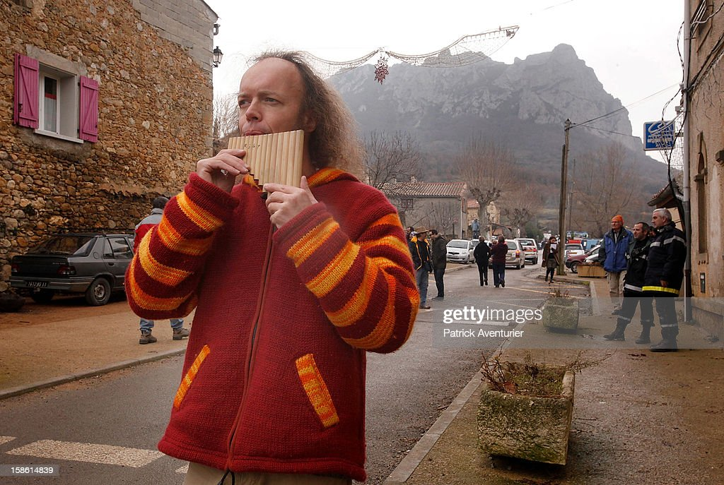 Sylvain Durif, aka Durif Oriana, who claims to embody 'the energy of the Cosmic Christ announced by Nostradamus', plays some pan pipes after the time passed 11.11 am, the time the Mayan Apocalypse was supposed to occur in Bugarach village on December 21, 2012 in Bugarach, France. The prophecy of an ancient Mayan calendar claimed that today would see the end of the world, and that Burgarach is the only place on Earth which will be saved from the apocalypse.