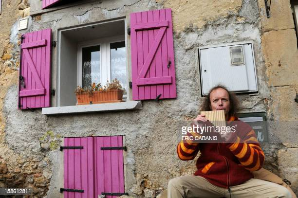 Sylvain Durif presenting himself as the messanger of God and Christ plays panpipes on December 21 in the streets of the French southwestern village...