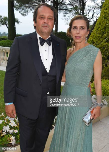 Sylvain Ercoli and Dali Feller arrive at the amfAR Gala Cannes 2017 at Hotel du CapEdenRoc on May 25 2017 in Cap d'Antibes France