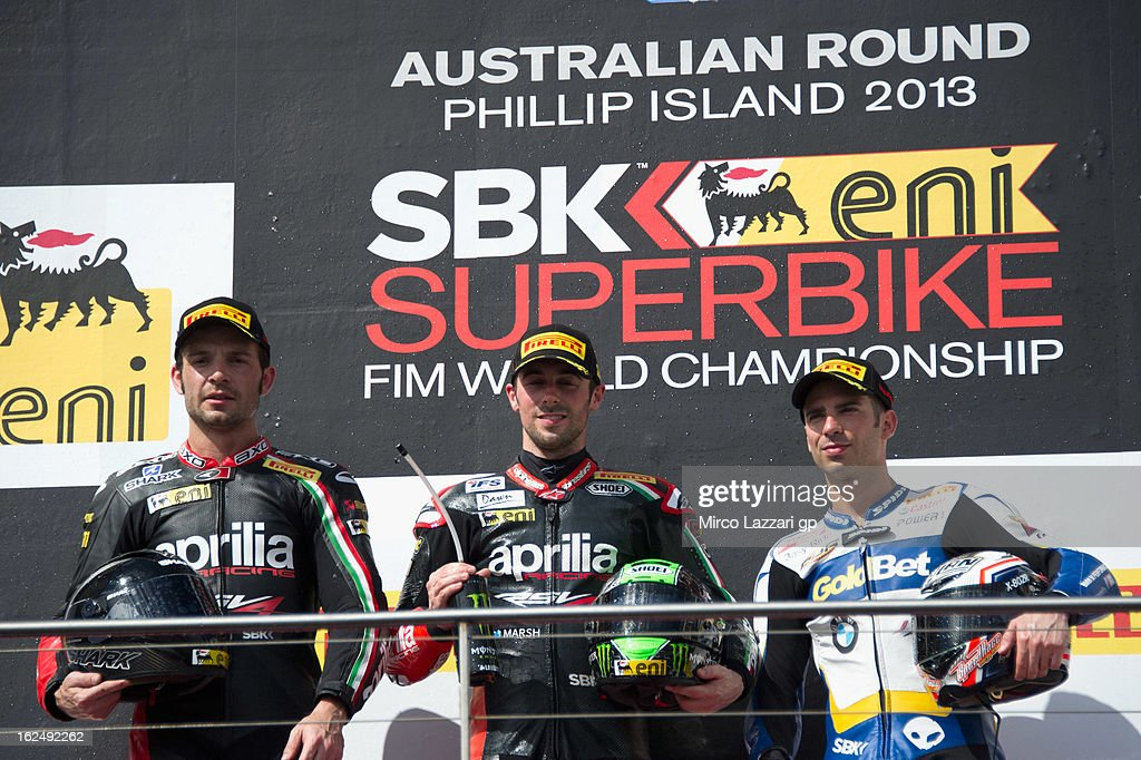 Sylvain Giuntoli of France and Aprilia Racing Team and <a gi-track='captionPersonalityLinkClicked' href=/galleries/search?phrase=Eugene+Laverty&family=editorial&specificpeople=4253466 ng-click='$event.stopPropagation()'>Eugene Laverty</a> of Ireland and Aprilia Racing Team and <a gi-track='captionPersonalityLinkClicked' href=/galleries/search?phrase=Marco+Melandri&family=editorial&specificpeople=204382 ng-click='$event.stopPropagation()'>Marco Melandri</a> of Italy and BMW Motorrad GoldBet SBK celebrate on the podium at the end of race 2 during the first round of 2013 Superbike FIM World Championship at Phillip Island Grand Prix Circuit on February 24, 2013 in Phillip Island, Australia.