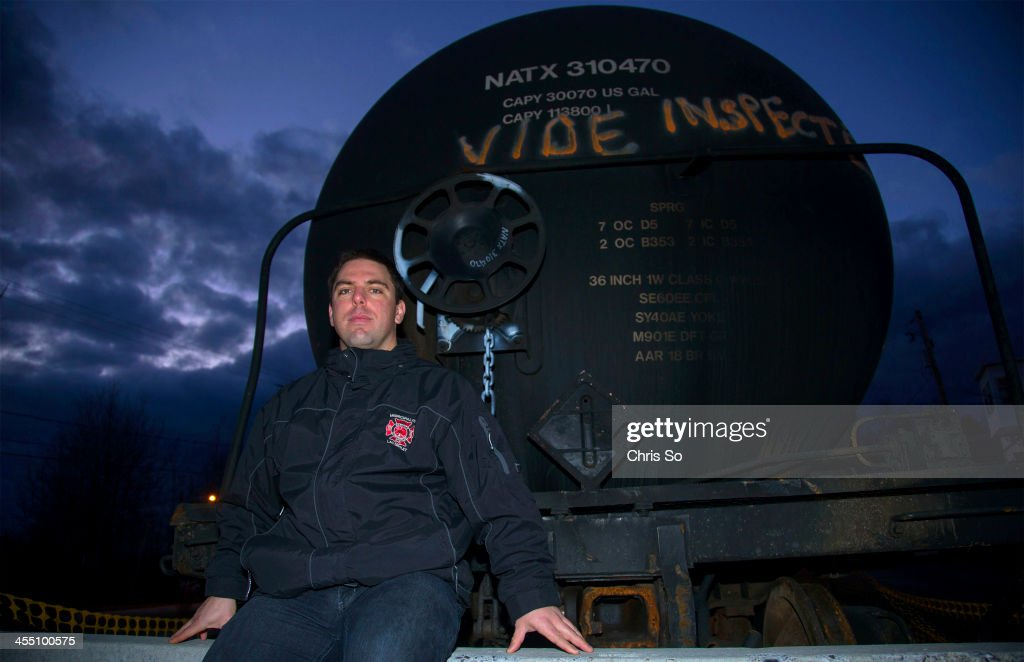 Sylvain Grégoire sits by a remaining MMA tanker car in LacMégantic Grégoire is an industrial fire specialist at a large particle board manufacturing...