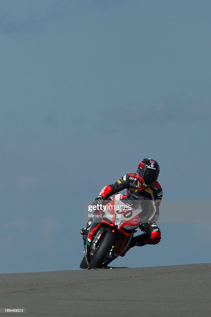 Sylvain Guintoli of France and Aprilia Racing Team heads down a straight during the World Superbikes - Qualifying during the round five of 2013 Superbikes FIM World Championship at Donington Park on May 25, 2013 in Castle Donington, England.