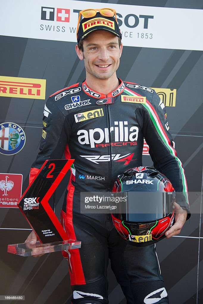 Sylvain Guintoli of France and Aprilia Racing Team poses and celebrates the second place at the end of the Super Pole during the World Superbikes - Qualifying during the round five of 2013 Superbikes FIM World Championship at Donington Park on May 25, 2013 in Castle Donington, England.