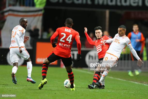 Sylvain Marveaux of Lorient and Rami Bensebaini of Rennes during the French Ligue 1 match between Rennes and Lorient at Roazhon Park on February 25...