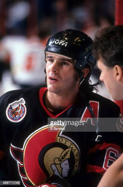 Sylvain Turgeon of the Ottawa Senators looks on during warmups before an NHL game against the Philadelphia Flyers on February 9 1993 at the Spectrum...