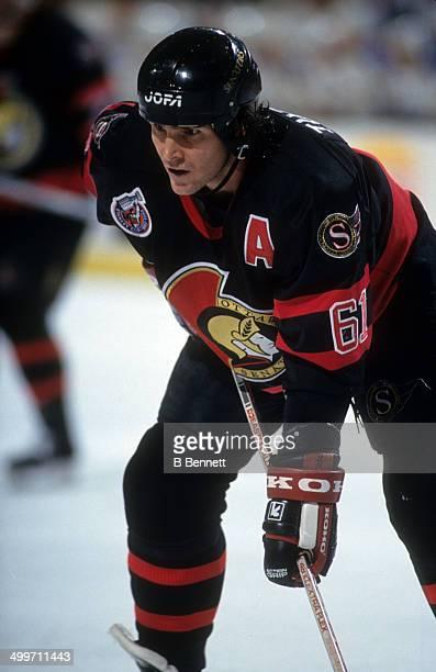 Sylvain Turgeon of the Ottawa Senators waits for the faceoff during an NHL game against the Buffalo Sabres on November 27 1992 at the Buffalo...