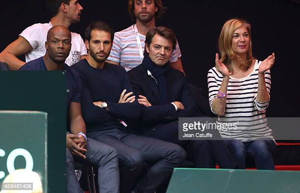 Sylvain Wiltord Francois Baroin and Michele Laroque attend day three of the Davis Cup tennis final between France and Switzerland at the Grand Stade...