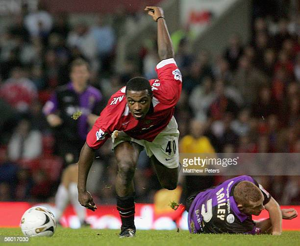 Sylvan EbanksBlake of Manchester United clashes with Nicky Bailey of Barnet during the Carling Cup third round match between Manchester United and...